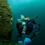 Diver takes samples of silt and algae